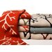 <strong>Eco Coral Throw Blanket</strong> by In2Green