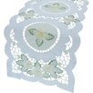 <strong>Xia Home Fashions</strong> Elegant Daisy Embroidered Cutwork Table Runner