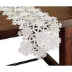 <strong>Shimmer Snowflake Embroidered Cutwork Table Runner</strong> by Xia Home Fashions