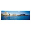 <strong>iCanvasArt</strong> Panoramic Buildings at the Waterfront with a Volcanic Mountain in the Background Hawaii Photographic Print on Canvas