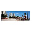 <strong>iCanvasArt</strong> Panoramic Jester Statue at Riverwalk Area, New Orleans, Louisiana Photographic Print on Canvas