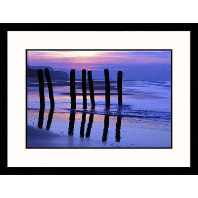 Wood Pylons and Ocean Framed Photograph