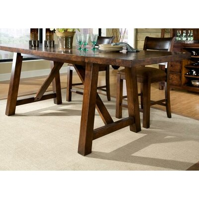Legacy Classic Furniture Woodland Ridge Rectangular Trestle Pub Table in Distressed Aged Amber