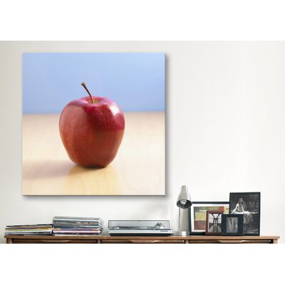 iCanvasArt Red Apple on Wood Desk Photographic