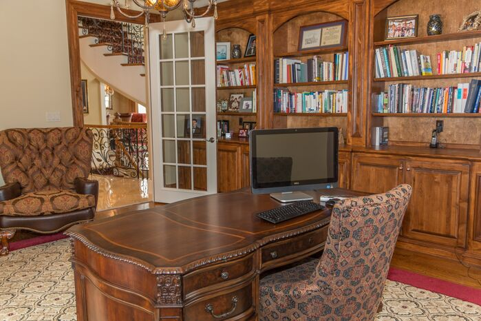 Traditional Home Office photo by J&L Interiors, LLC