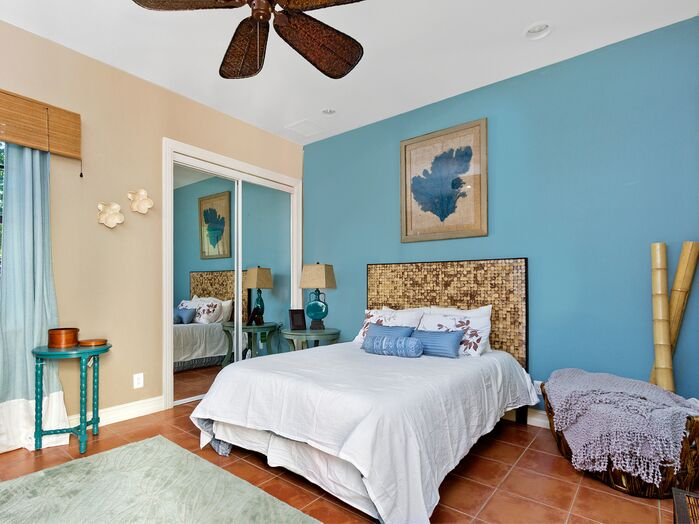 Coastal Bedroom photo by Interiors By Orshi