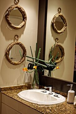 Coastal Bathroom photo by Interiors by Maite Granda, Inc