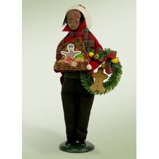 African American Man with Gingerbread Figurine