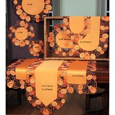 <strong>Xia Home Fashions</strong> Happy Jack-O-Lanterns Table Topper