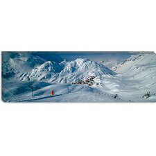 <strong>iCanvasArt</strong> Rear View of a Person Skiing in Snow, St. Christoph, Austria Canvas Wall Art