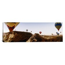 Panoramic Hot Air Balloons over Cappadocia at Sunrise, Central Anatolia Region, Turkey Photographic Print on Canvas