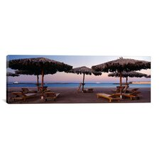 Panoramic 'Lounge Chairs with Sunshades on the Beach, Hilton Resort, Hurghada, Egypt' Photographic Print on Canvas