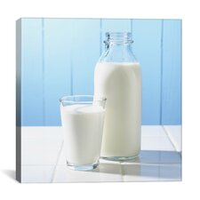 Milk Glass and Bottle on Counter Photographic
