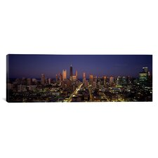 Panoramic Skyscrapers in a City Lit up at Dusk, Chicago, Illinois Photographic Print on Canvas