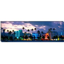 <strong>iCanvasArt</strong> Buildings Lit Up At Dusk, Ocean Drive, Miami Beach, Florida, Canvas Wall Art