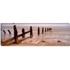 <strong>iCanvasArt</strong> Posts on The Beach, Spurn, Yorkshire, England, United Kingdom Canvas Wall Art