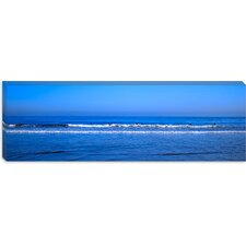 Surfers Riding a Wave in the Sea, Santa Monica, Los Angeles County, California Canvas Wall Art