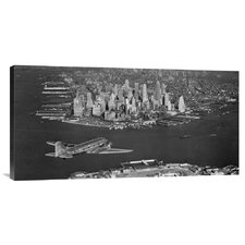 Airplane Flying Towards Manhattan Photographic Print on Canvas