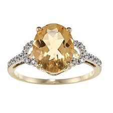 Gold Oval Cut Gemstone and Diamond Ring