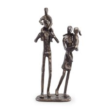 Parents Carrying Children Sculpture