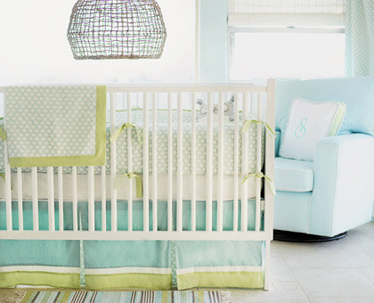 Light, Cool Tones Tiffany blue, pastel green, and a dash of  ​chocolate brown offer a traditional palette that feels fresh and new in this contemporary boys' nursery.