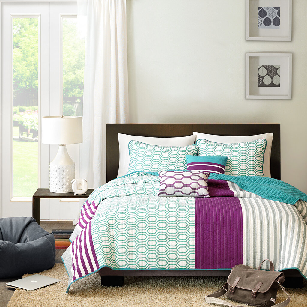 teal and purple geometric bedding
