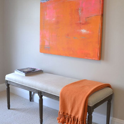 orange throw and artwork